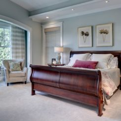 Master bedroom with sleigh bed and wall art above