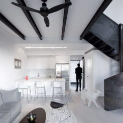 Minimalist Duplex Nam by gerstner featuring a spiral staircase design
