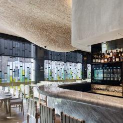 Modern Fucina restaurant with bulbous brick ceiling