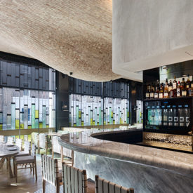 Modern Fucina restaurant with bulbous brick ceiling