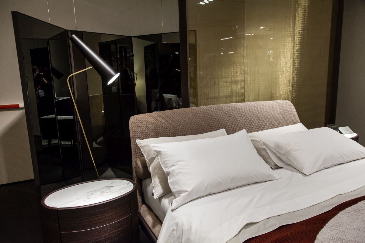 Floor lamps work at the bedside too.