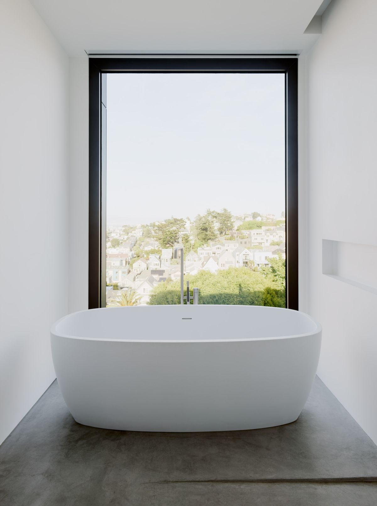 The gorgeous views can also be enjoyed from the bathroom which has this lovely bathtub nook with its own wall niche and large window