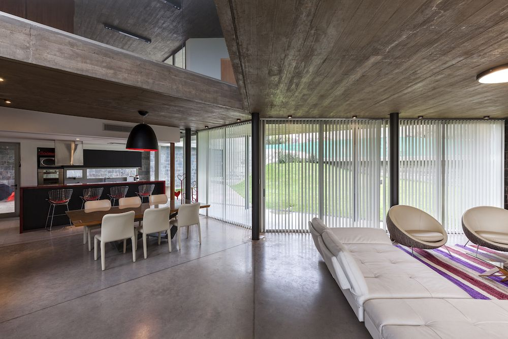 The interior design is simple and open, featuring polished concrete flooring on the lower level