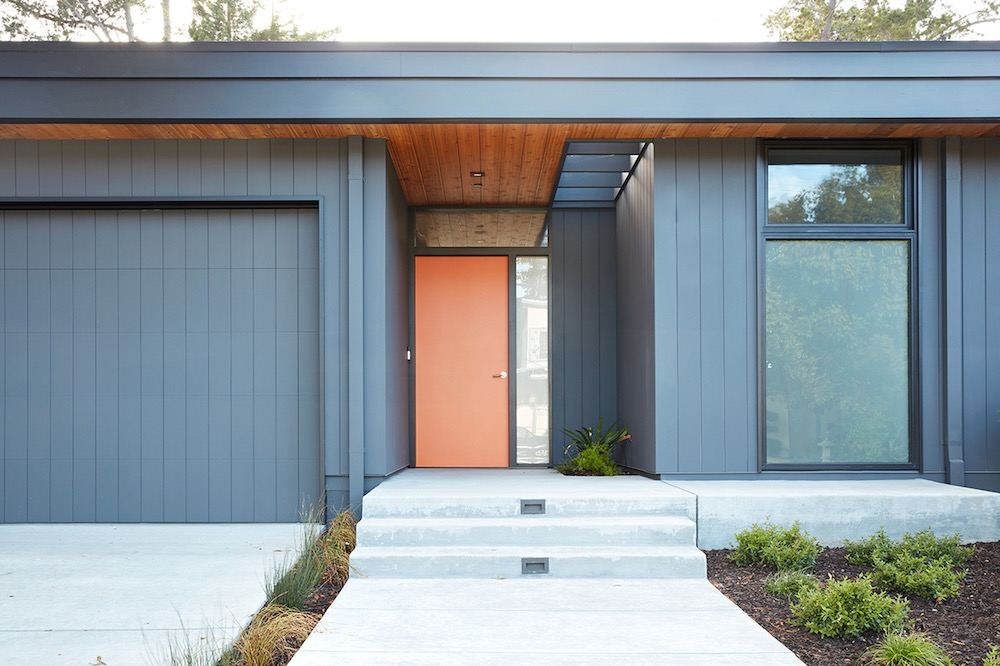 Although the overall design and architecture of the house are simple, there are also quirky details such as the orange front door