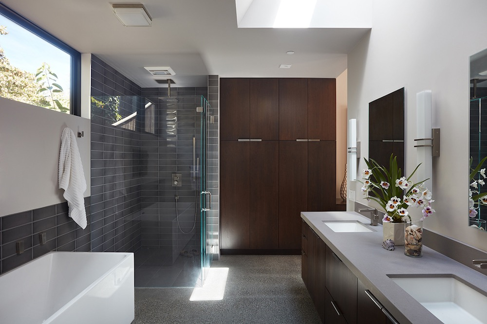The main bathroom is quite large and includes a separate glass shower, a double sink vanity and plenty of storage space