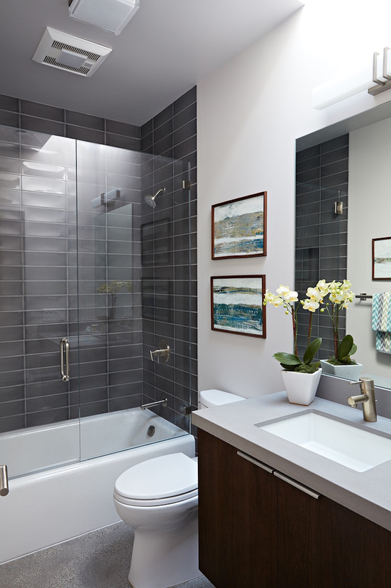 The smaller bathroom features a practical and space-efficient tub and shower combo