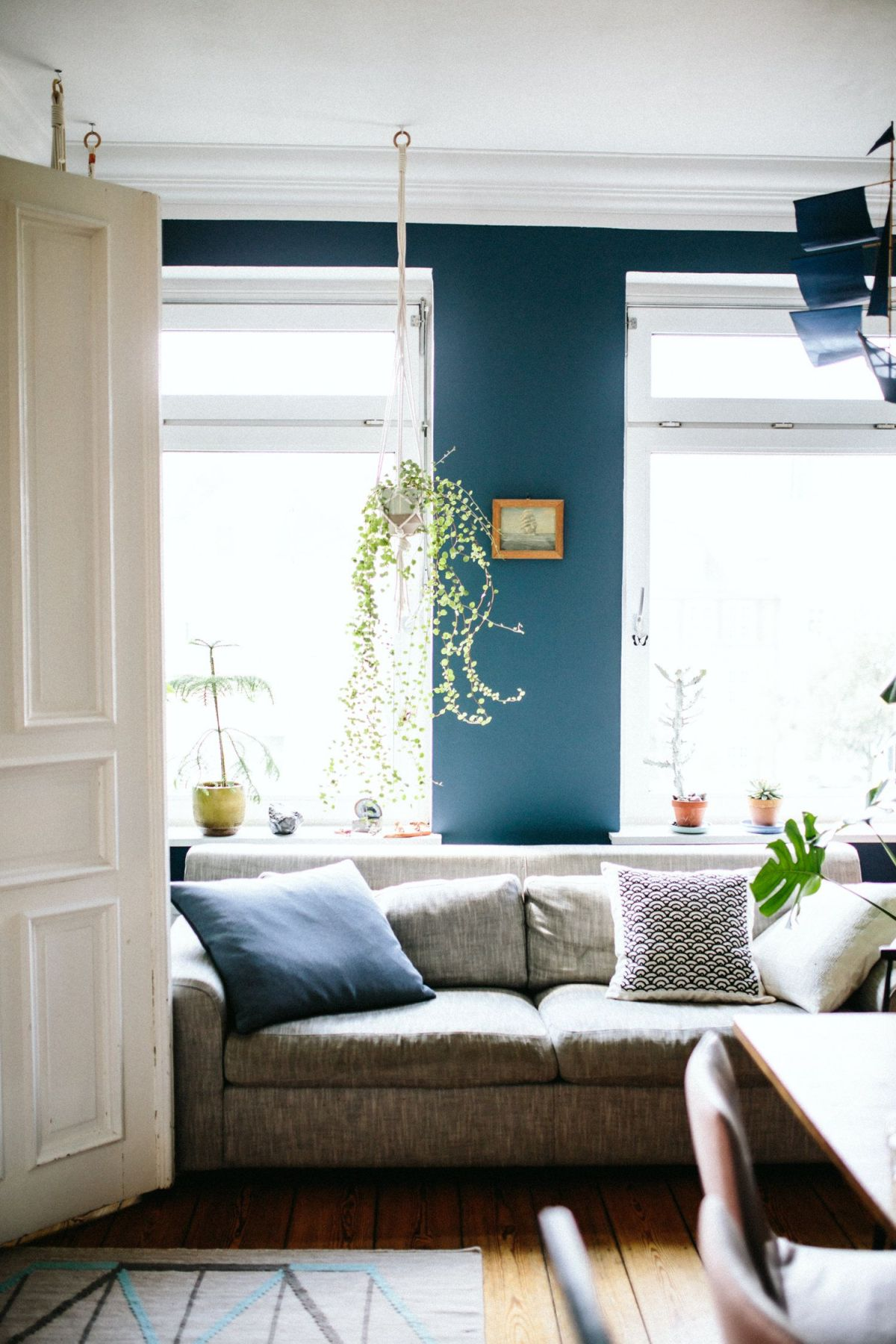 Scandinavian living room teal walls
