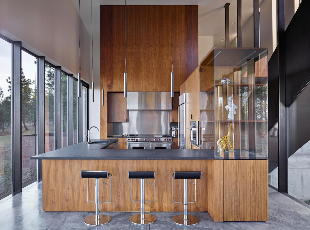 The kitchen is part of the open floor plan but manages to maintain an autonomous nature through an L-shaped counter