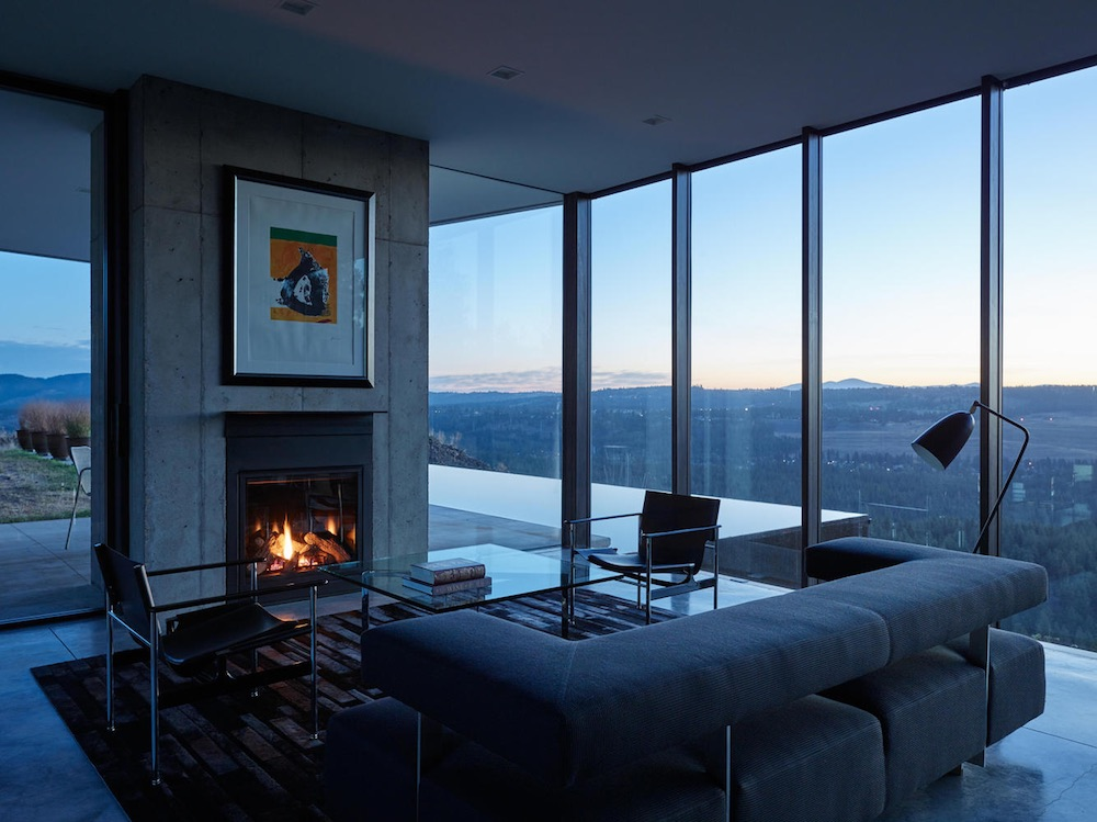 Floor-to-ceiling windows allow 180 degree views over the forest, the mountain and the city to be enjoyed from the living room