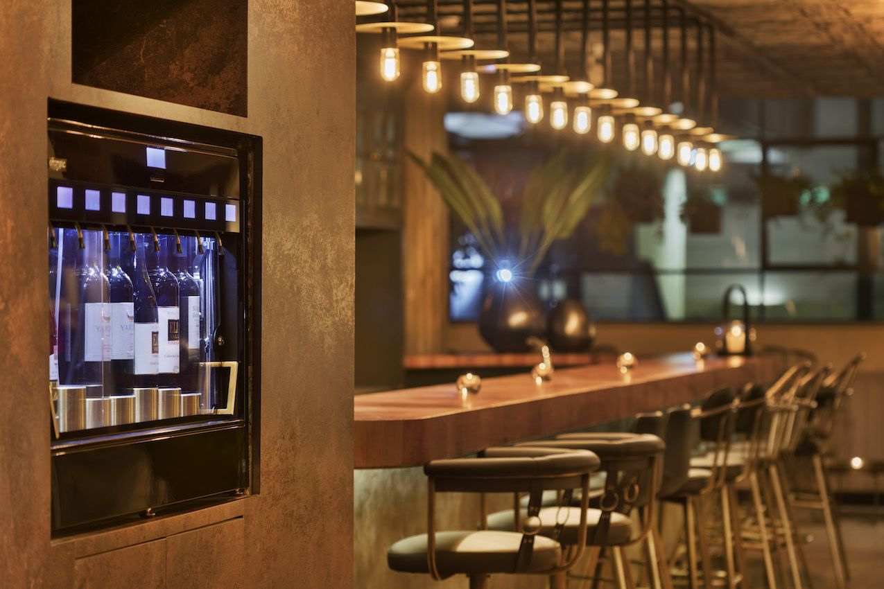 Guests can order at the bar or serve themselves at a wine-dispensing machine.