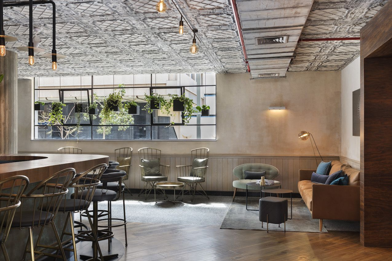 Understated, modern furnishings highlight the lobby and bar area.