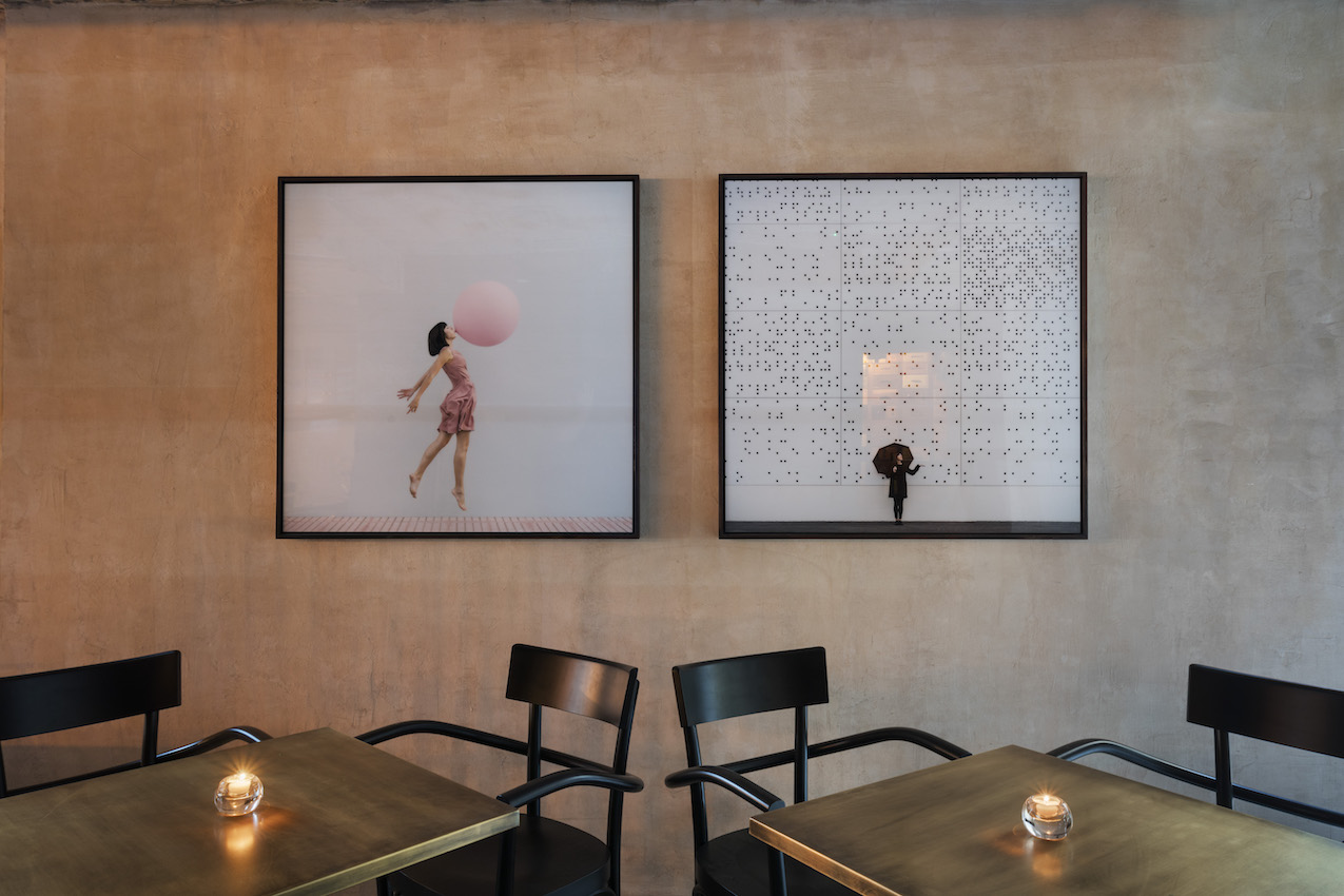 Artwork highlights the seating area of the lounge.