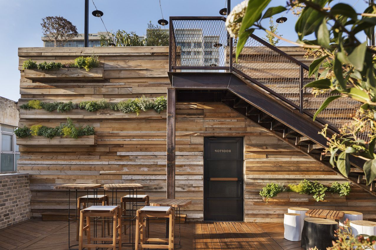 The design of the rooftop space is natural, rustic and relaxed.