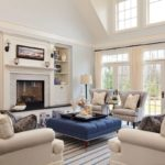 Traditional living room blue tufted ottoman