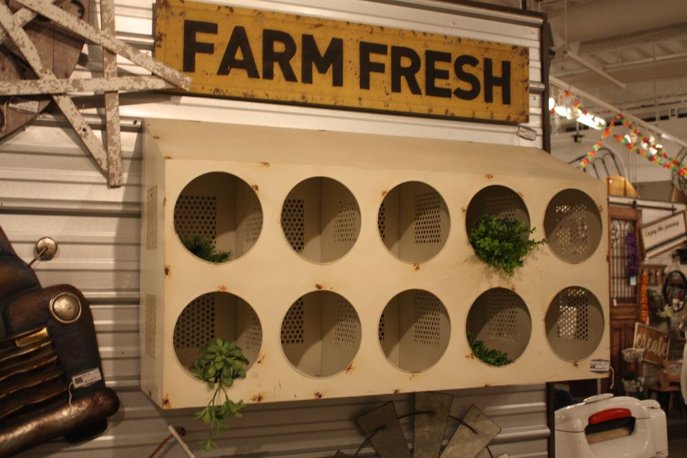 An old chicken coop becomes a decorative wall unit.
