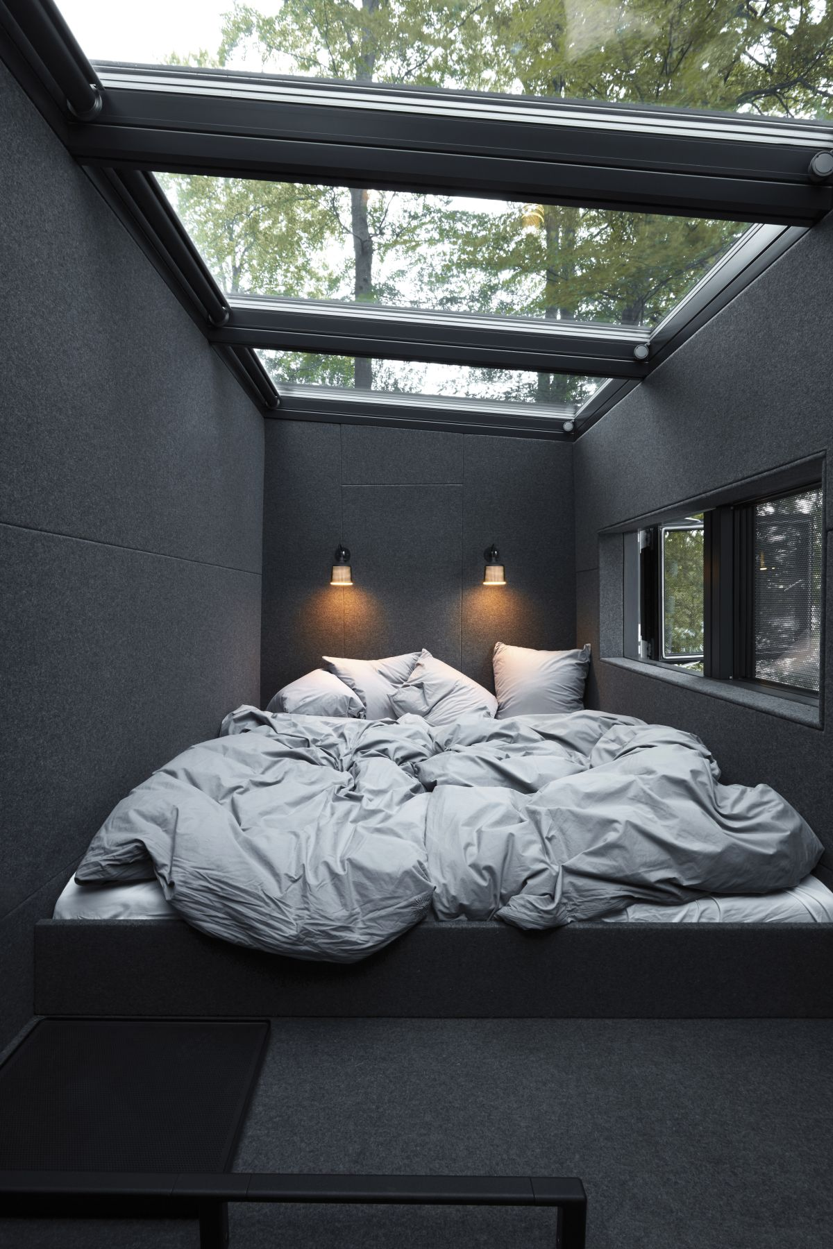 One of the protrusions on the roof houses a small and narrow sleeping loft with ceiling skylights