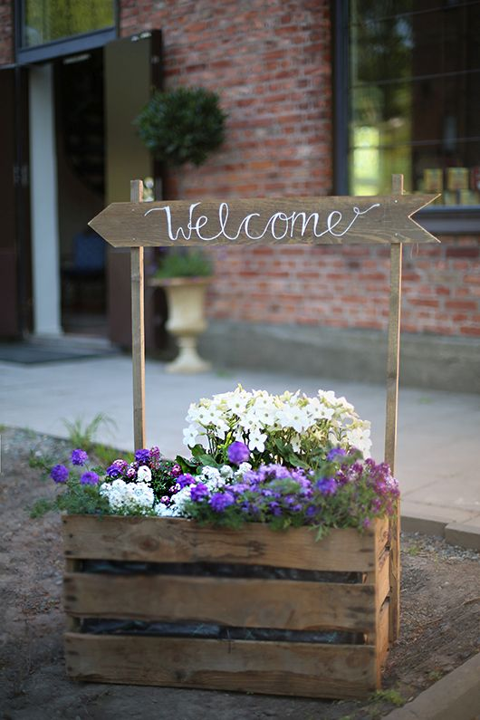 Welcome everyone with a beautiful sign