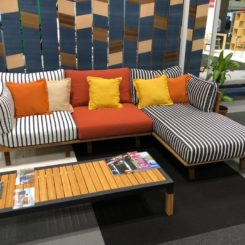 The wood frame complements the upholstery colors.