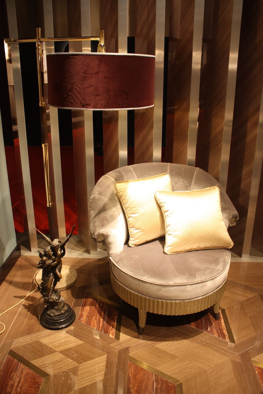 A sumptuous velvet chair is accented with satin pillows.