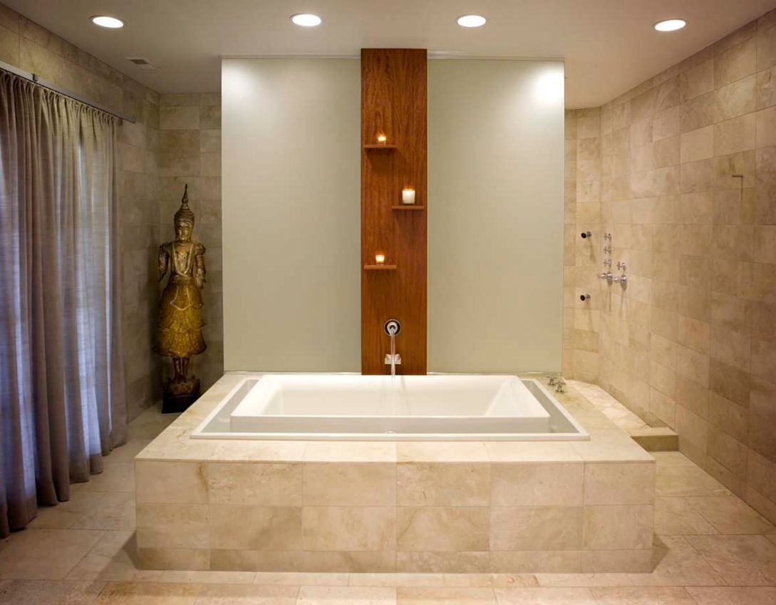 A tall metal Asian statue emphasizes the Zen feeling of this Chicago bathroom's design.