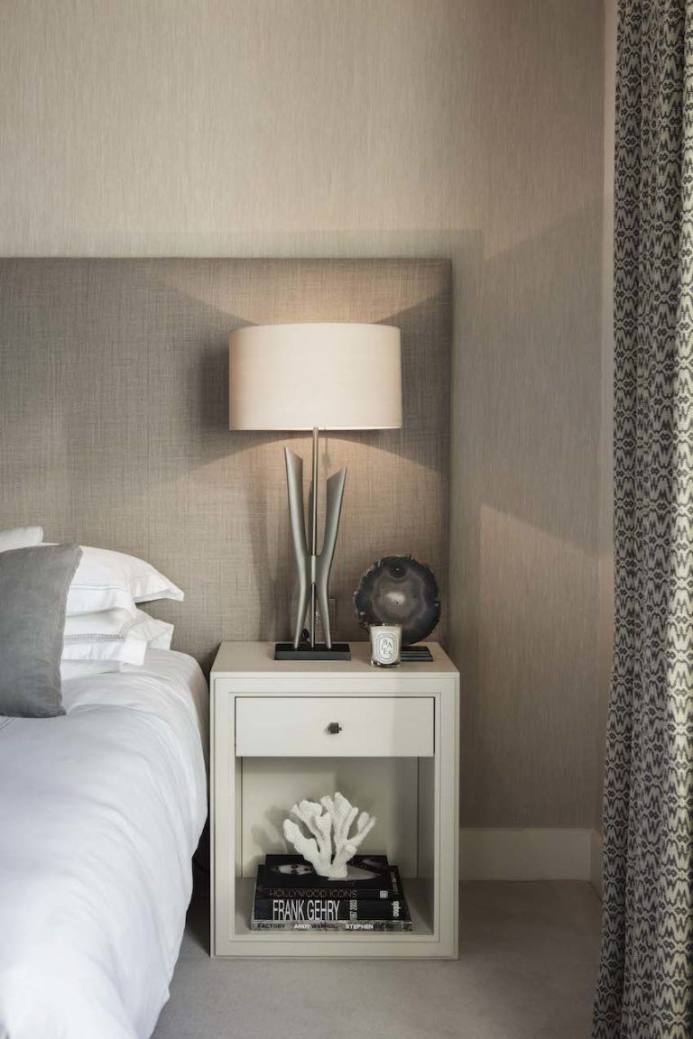 LIght-colored bedside tables keep the room serene.