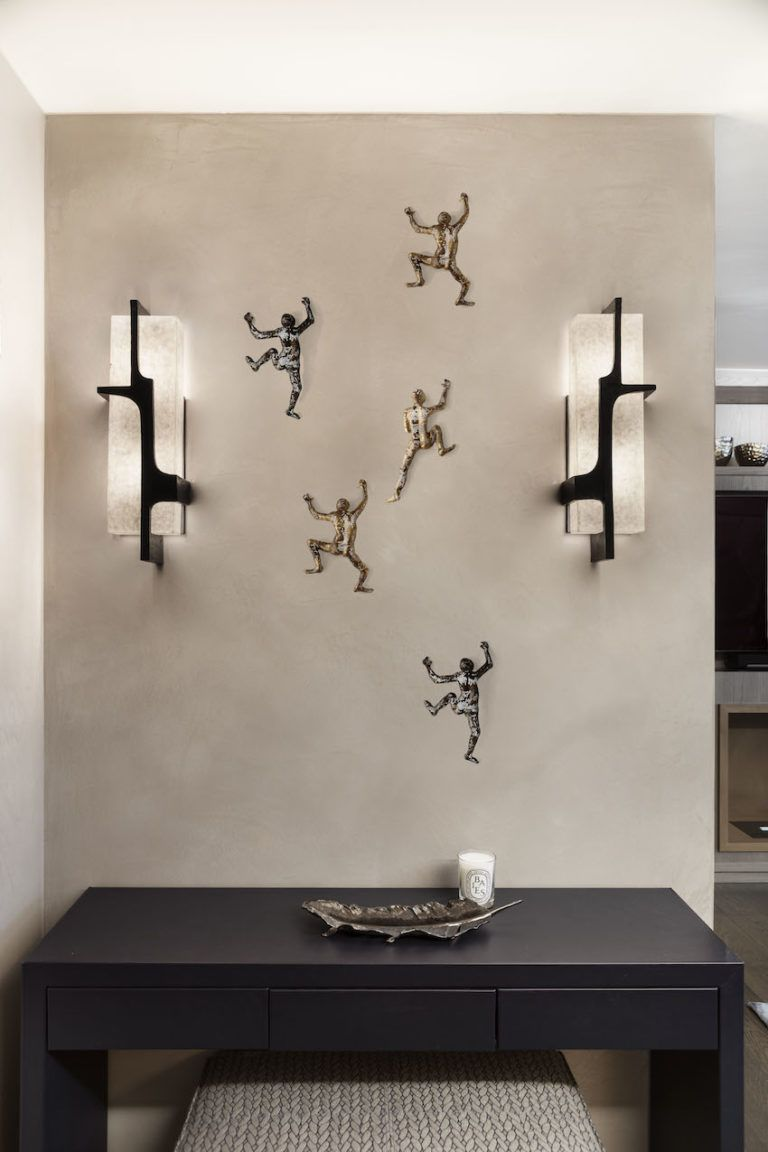 A feature wall with art is perfect for an entryway.