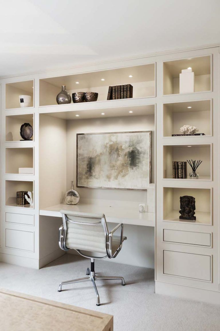 Built-in shelving and storage prevent the space from feeling cluttered.