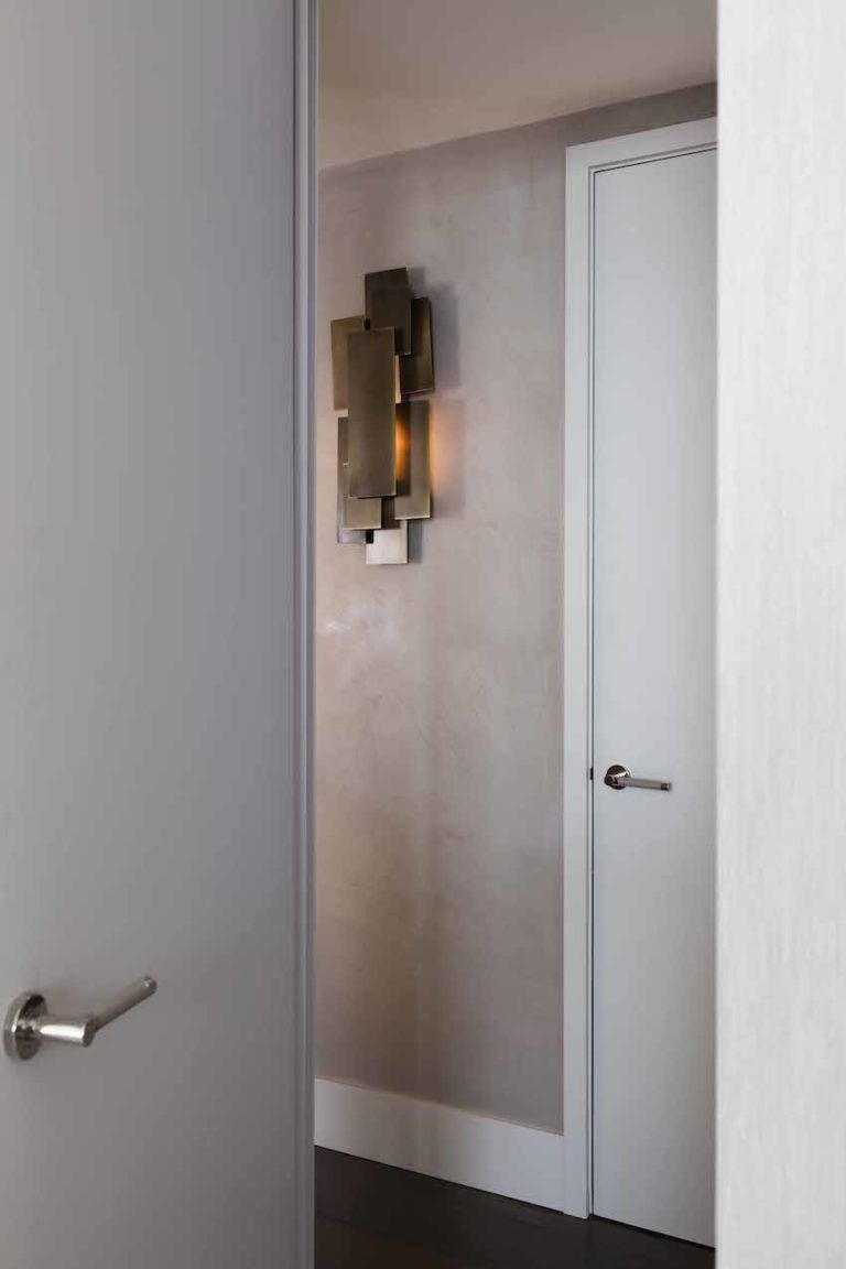 Artful sconces are ideal for a plain hallway.