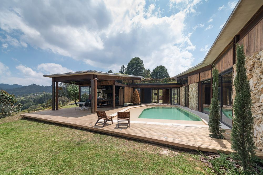 A common deck with a pool built into it allows the inhabitants to enjoy the outdoors without adventuring too far from the living spaces