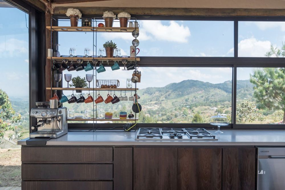 The kitchen lacks wall-mounted cabinetry but has its own way of being storage-efficient