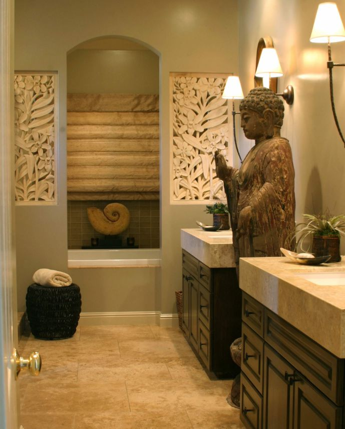 A full-size statue makes this bathroom feel like a spa.