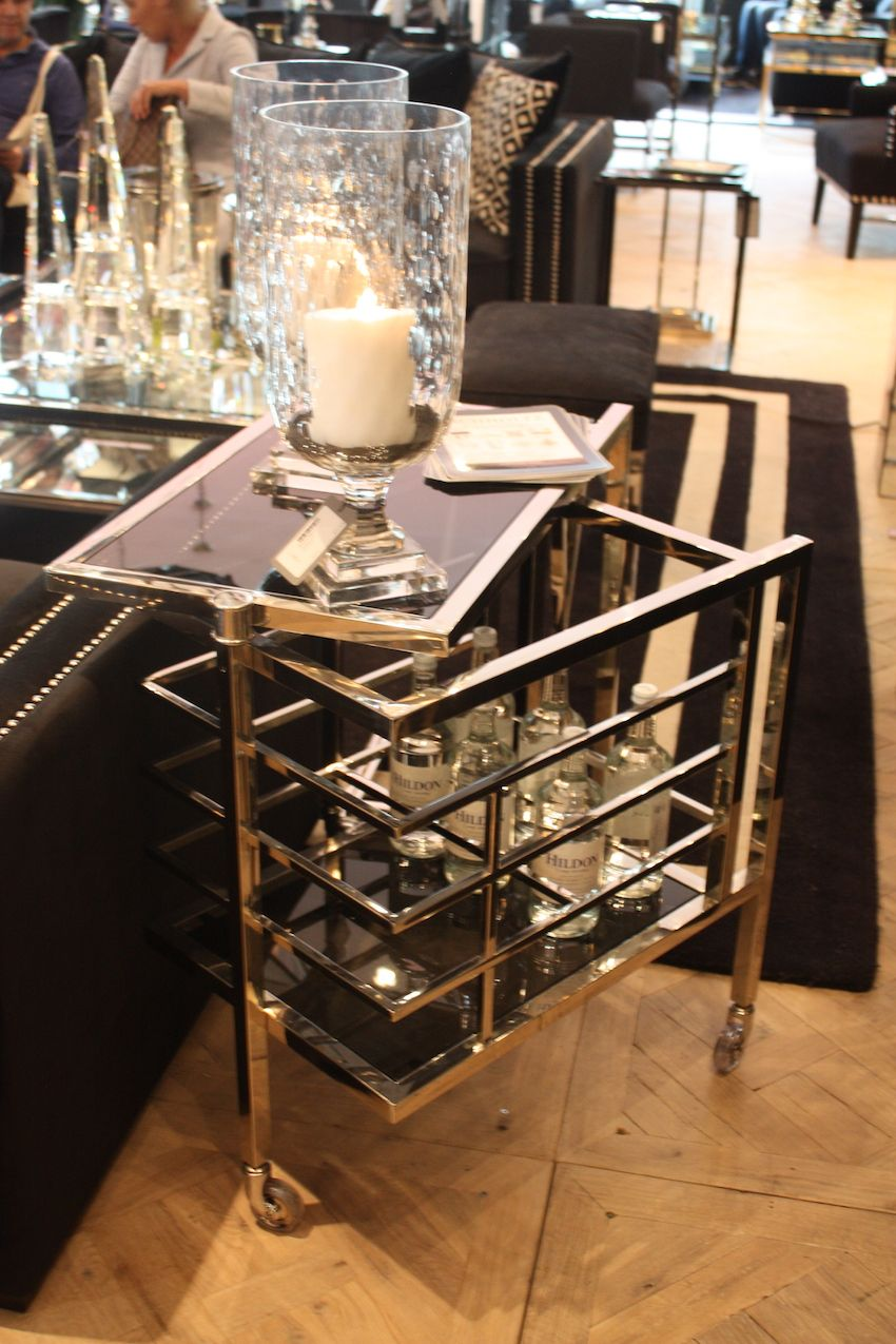 Smaller chrome pieces like Eichholz bar cart are fitting additions.