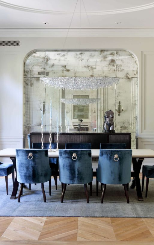 A metallic torso statue is an elegant accessory for this dining room.