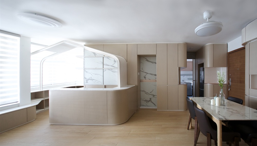 Marble surfaces scattered throughout the apartment give the space a chic and sophisticated vibe