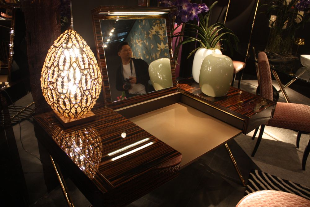 High gloss wood and lacquer bring depth and shine to the decor.