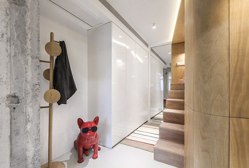 This shallow nook on the hallway didn't go to waste either. It accommodates a coat tree and a cool sculpture