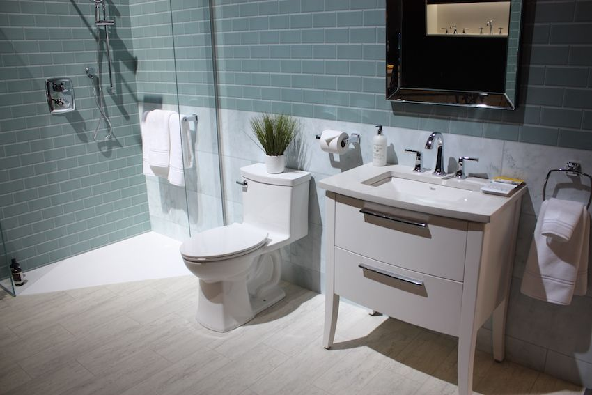 Porcelain tile is the most durable option for a bathroom as in this bathroom by American Standard..