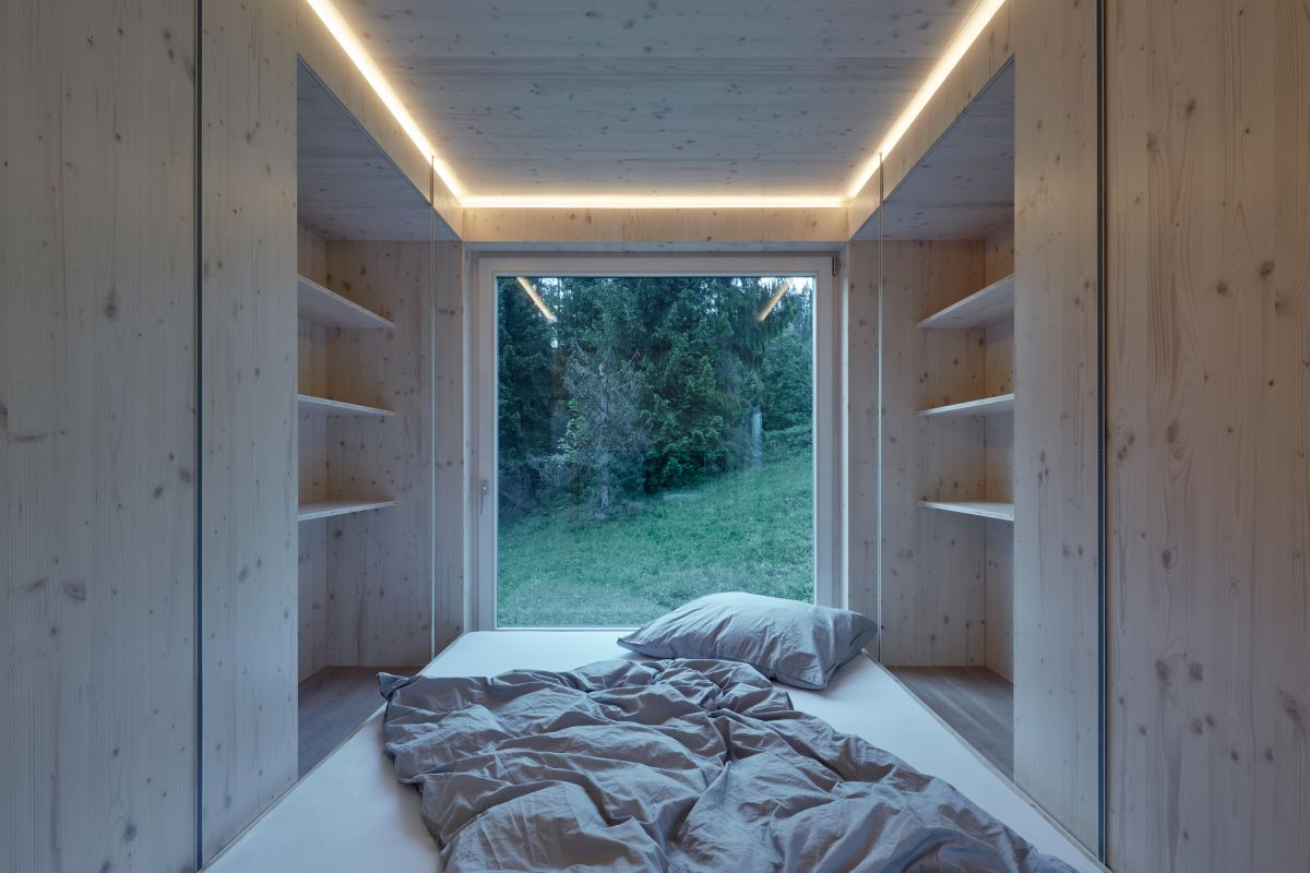 Another zone serves as a bedroom with storage on either side of the bed