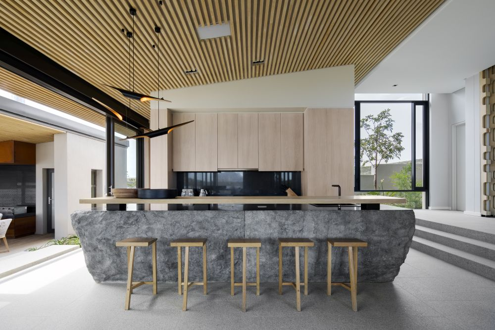 The kitchen island is a giant solid block of granite and serves as a focal point of interest for the entire house
