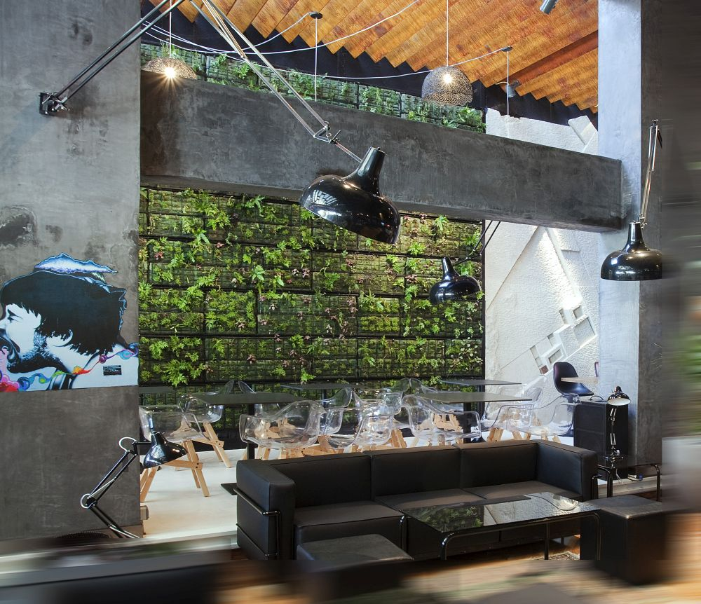 An Athens coffee shop uses green walls to create the impression of being in a garden.