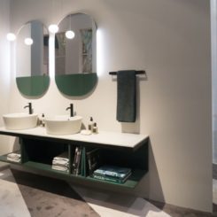 Double vanity with open space and round vesel
