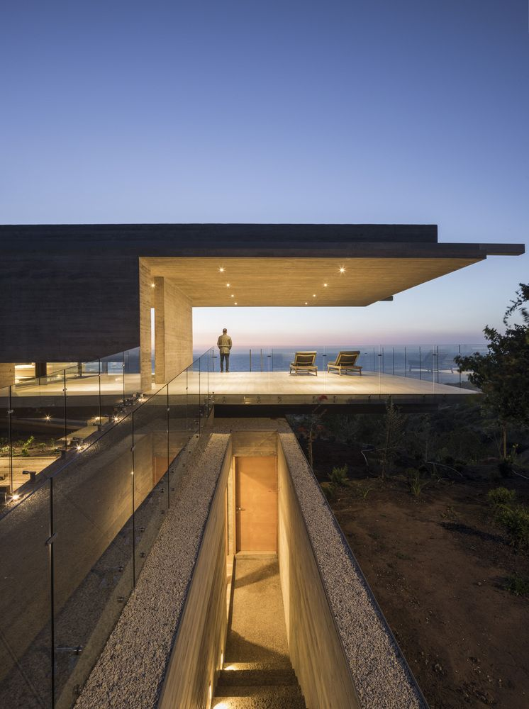 The two terraces at the ends of the structure have roofs with built-in lighting and glass railings all around them