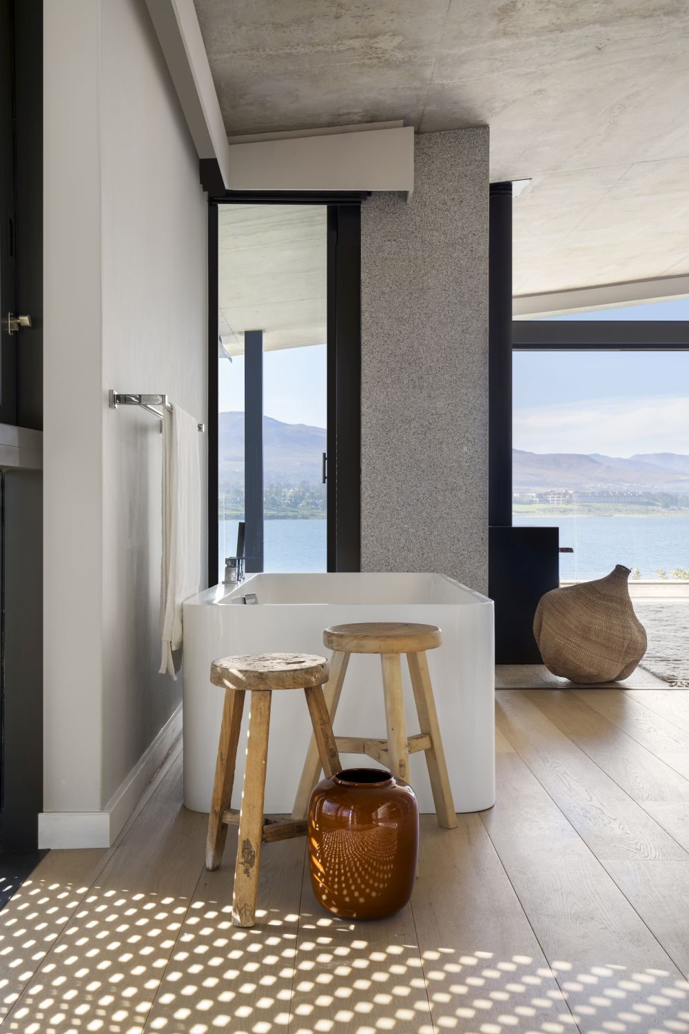 The bathrooms are designed to frame splendid views of the water as well and they're filled with natural light