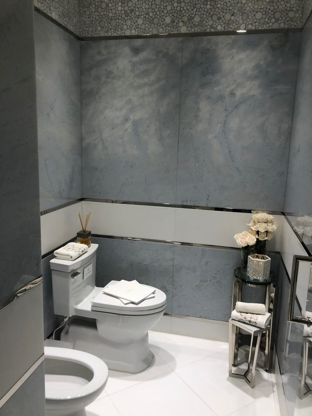 Large-scale or slab tiles are ideal for mixing with other styles of tile.