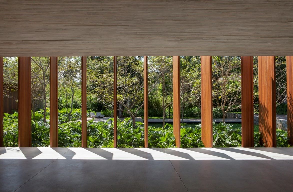 These pivoting wood panels can offer a flexible level of privacy for the indoor areas based on the users' needs