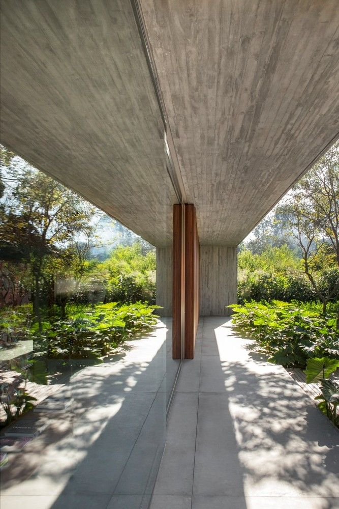 Glass walls, sliding doors and pivoting panels allow the interior spaces to open up to the outdoors
