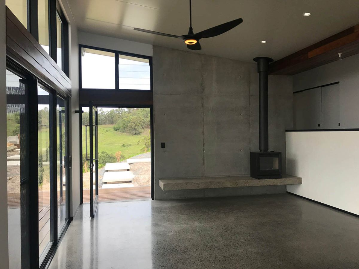 The interior of the house is quite modest too, featuring polished concrete floors and exposed walls throughout