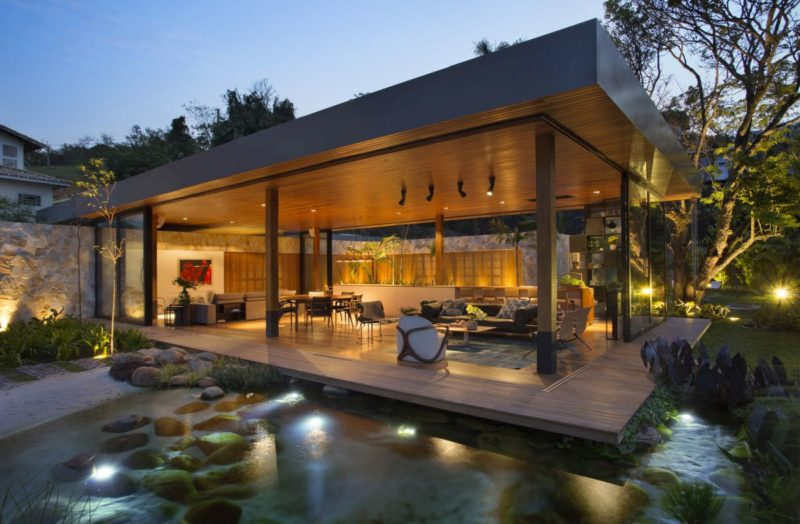 Cozy Family Home Floats Above A Fish Pond