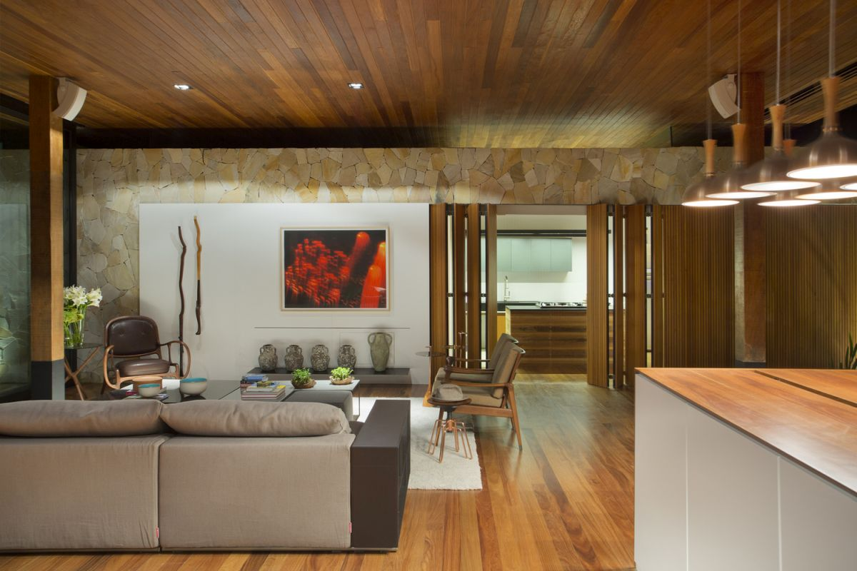 Wood and stone are the two primary materials featured throughout the house in various combinations