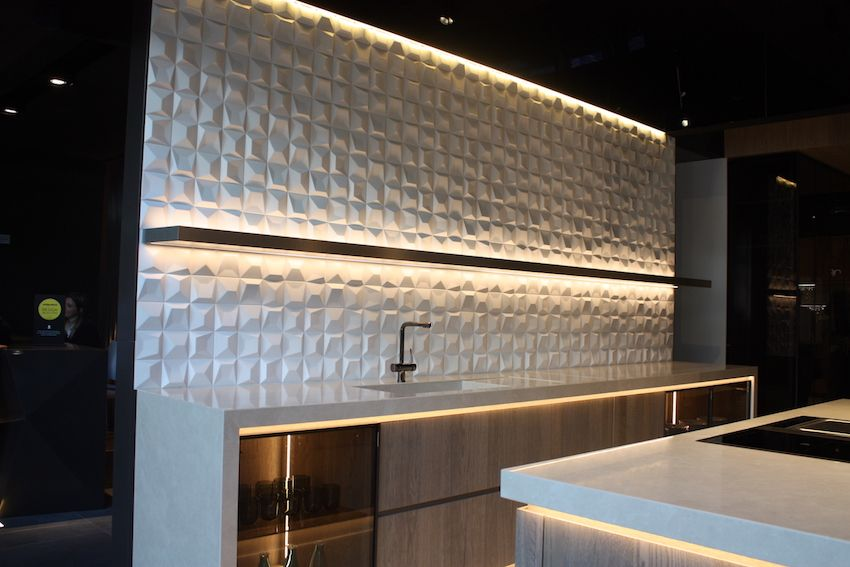Porcelanosa's kitchen backsplash is dramatic because of the ceramic tile style.
